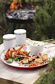 Barbecued prawn skewers on wooden table