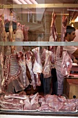 View through window into butcher's shop