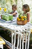 Children sitting at set table in garden