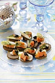 Canapes with smoked salmon, egg and caviar