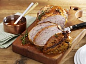 Stuffed breast of veal on chopping board