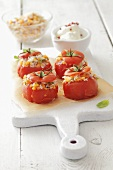 Baked tomatoes with rice and lentil stuffing