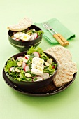 Mixed salad with radishes, gherkins and feta cheese, flatbread