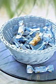 Almond caramels in a pale blue basket