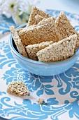 Sesame bars in pale blue bowl