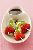 Strawberries, mozzarella, olives and basil on cocktail sticks