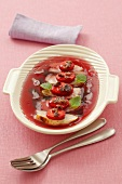 Chicken breast with strawberries and raisins in red wine jelly