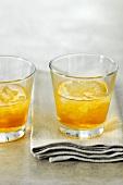 Two glasses of orange liqueur
