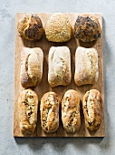 Assorted bread rolls on chopping board