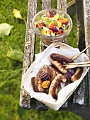 Barbecued sausages with ratatouille salad