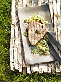 Barbecued tuna steak with lime cabbage