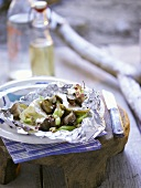 Camembert, pear, leeks and mushrooms barbecued in aluminium foil