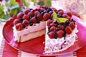 Raspberry cream cake with meringue crumbs