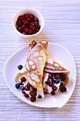 Pancakes with cream and berries