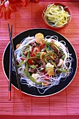 Beef and vegetable stir-fry on rice noodles