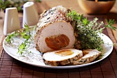 Roast pork with apricot stuffing, slices carved