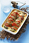 Courgette and tomato bake in baking dish