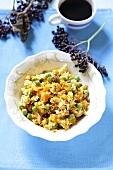 Rice, pumpkin, pea and raisin salad