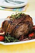 Roast lamb with herbs, onions and peppers
