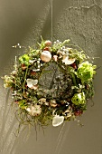 Flower wreath hanging by a wall