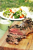 Leg of lamb with herbs and vegetable salad
