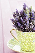 Bunch of lavender in a cup and saucer