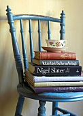 Books and cup and saucer on chair