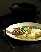 Sweet potato and pumpkin soup with rice noodles and tuna skewer