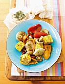 Barbecued vegetables (mushrooms, corn, peppers, onions) with basil & lemon marinade