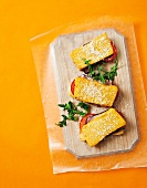 Polenta sandwiches with ham and tomato filling