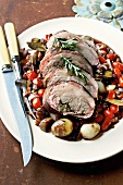 Stuffed fillet of lamb and vegetables in red wine