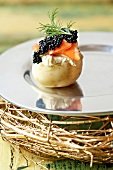Potato with cream cheese, smoked trout and caviar
