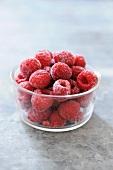 Frozen raspberries in glass dish
