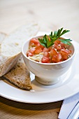 Hummus with diced tomatoes, bread