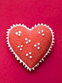 Red sugar heart with white spots