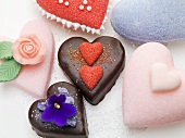Sugar hearts and heart-shaped chocolate cakes for Valentine's Day