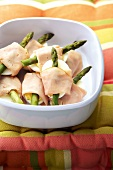Boiled eggs with ham and green asparagus