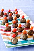 Meatballs and tomatoes on cocktail sticks