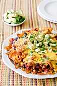 Chicken nachos with melted cheese and avocado