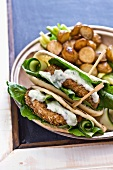 Pita bread filled with fish cakes and tzatziki