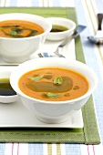 Cream of pumpkin soup with herb oil