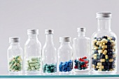 Assorted capsules and tablets in bottles