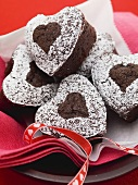 Chocolate hearts sprinkled with icing sugar