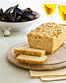 Beer bread, partly sliced, mussels