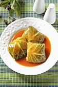 Stuffed savoy cabbage leaves with tomato sauce