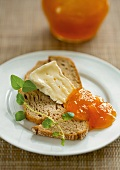 Camembert cheese and apricot jam on bread