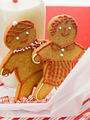 Gingerbread people, mints and bottle of milk