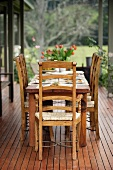 Rustic table on terrace (laid)