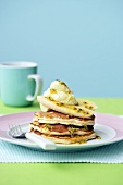 Pancakes with ricotta, banana and passion fruit sauce