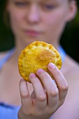 Woman holding meat pie
